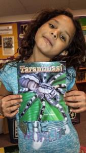 Jealynn showcasing her new tarantula book.